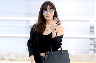 Tiffany墨镜遮面露香肩